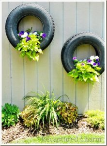 hanging flowers on old tyres